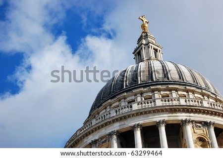 The top section of St Paul's Cathedral in London with sky. - stock photo