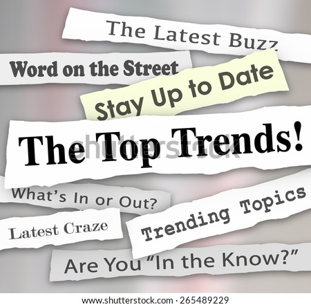 The Top Trends words in newspaper headlines to illustrate the hottest or latest new ideas, products, fads, fashions or innovations popular and in demand by customers - stock photo