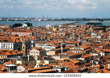 The top view for inhabited quarters of Venice and the auto-railway bridge of Freedom connecting Venice with continent - stock photo