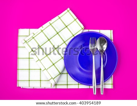 the top view of empty  red dish and towel on vibrant color background - stock photo