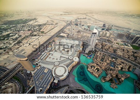 The top view on Dubai from the highest tower in the world, Burj Khalifa - stock photo