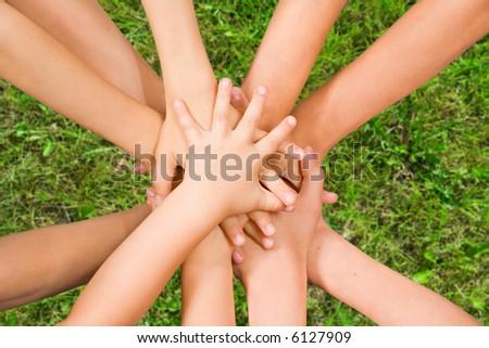 The top view on handshake of children - stock photo