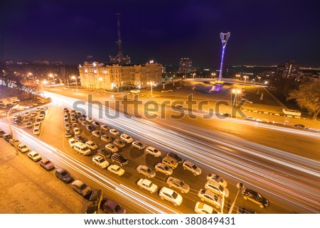 The top view on the road and the night city. Fires of roads on long exposure. The night road on long exposure. Traffic at night. Rostov-an-Don city. - stock photo