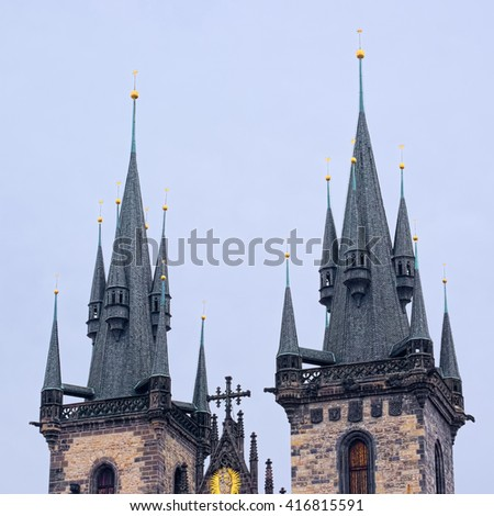 The tops of two towers of Church of Our Lady (Tyn Church) in Prague, Czech Republic, at winter overcast day.  - stock photo