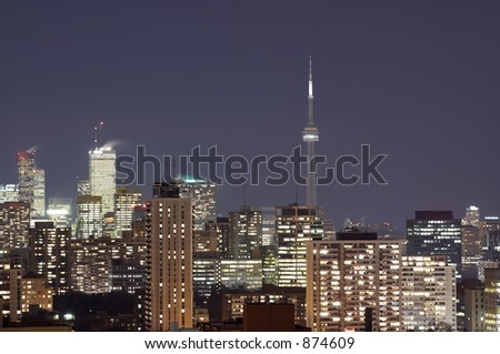 The Toronto skyline at night with the CN Tower in the background. - stock photo