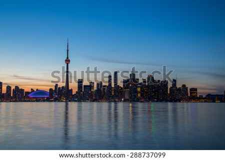The Toronto Skyline during the blue hour showing much of the downtown core buildings - stock photo