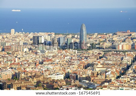 The Torre Agbar in the Barcelona district Poblenou. The Tower is surrounded by other skyscrapers. Barcelona is a vibrant modern city with an old, modern or Postmodern architecture - stock photo