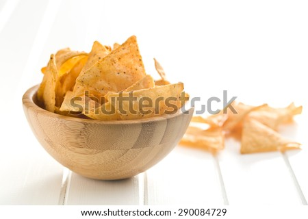 the tortilla chips in bowl - stock photo