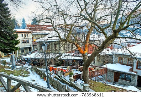 The tourist street of old Metsovo with the cozy family restaurants and taverns, offering best local cuisine, Greece.