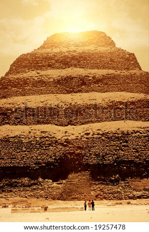 The touristic Sakkara pyramid under a sunset sky and ambient. - stock photo