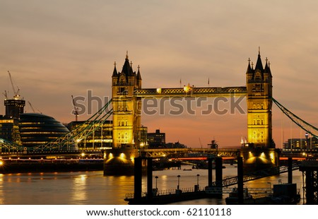 The Tower Bridge and the river Thames  in London at dusk - stock photo