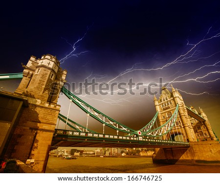 The Tower Bridge in bad weather. Dramatic sky in London. - stock photo