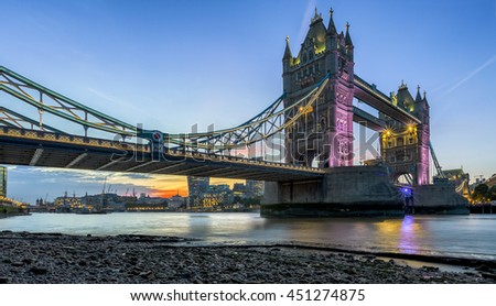 The Tower Bridge in London at sunset, seen from the thames shore