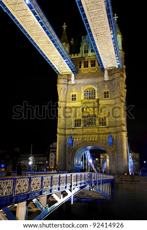 The Tower bridge  in London illuminated at night - stock photo