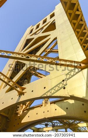 The Tower Bridge (1935) is a vertical lift bridge that crosses the Sacramento River in Sacramento, California. - stock photo