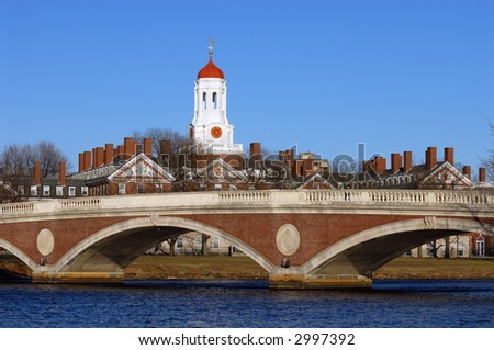 The tower of Harvard University's Dunster House and John W. Weeks Bridge over Charles River, in Cambridge, Massachusetts. - stock photo