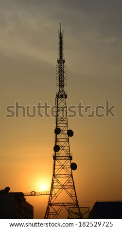 The towering radio towers in the sunset