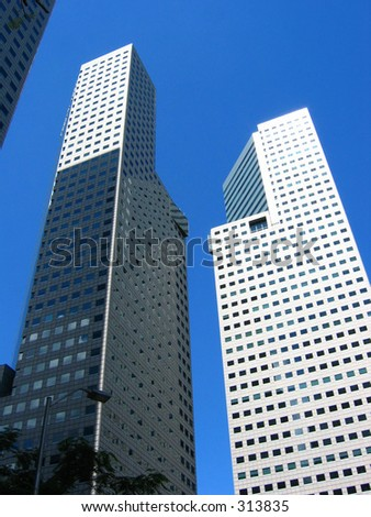 The towers of Suntec City on a clear blue sunny day - stock photo