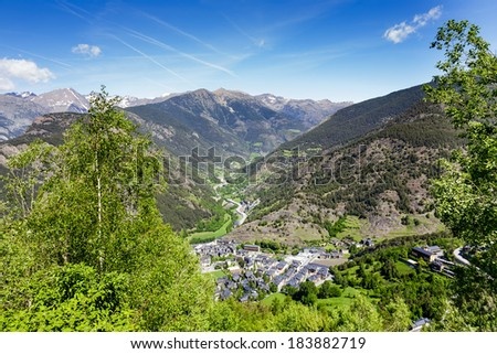 The town in a valley surrounded by stunning mountains at the Pyrenees in Andorra - stock photo