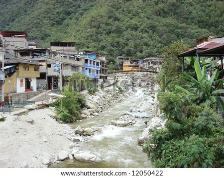 The town of Aqua Calientes, along the Urubamba River in the Andes Mountains of Peru, near Machu Picchu - stock photo