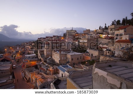 The town of Safed in northern Israel in the evening.  - stock photo
