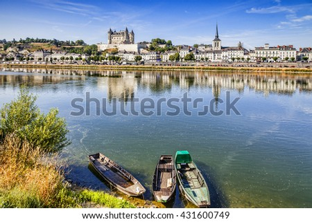 The town of Saumur reflecting in the River Loire on a sunny summer morning.