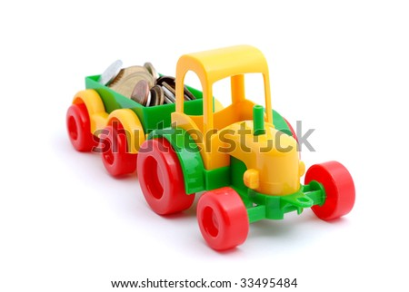 The toy excavator wheels money on white background