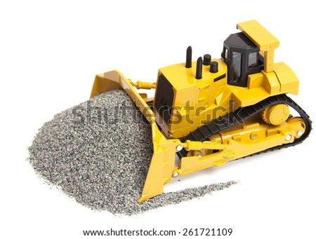 The toy heavy bulldozer of yellow color on a white background - stock photo