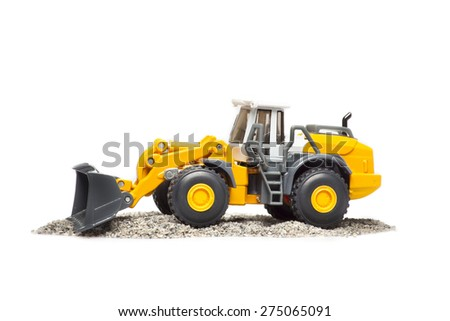 The toy heavy bulldozer of yellow color on a white background
