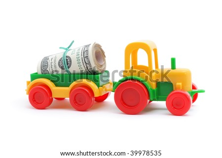 The toy tractor transortation money on white background