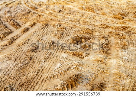 The trace of a tyre in the sand. - stock photo