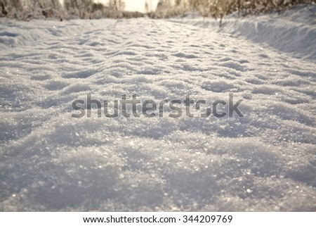 The traces left on snow from the lorry (on a sunset, traces pass through a field, instead of through road). Sunset winter background - stock photo