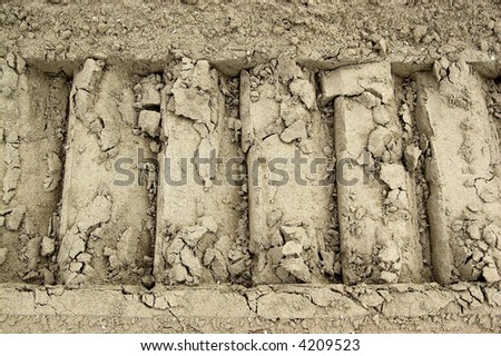 The track of the caterpillar on the sand - stock photo