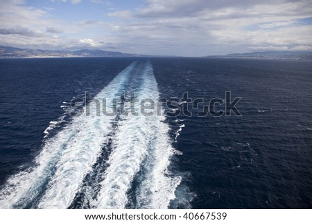 The track of the ship with dramatic sky. - stock photo
