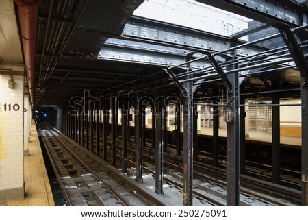 The tracks and support beams at the 110th St MTA station in New York City.