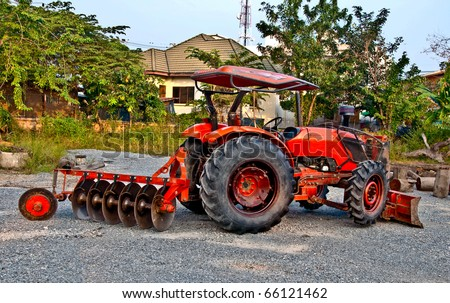 The Tractor on the road background - stock photo