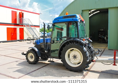 The tractor-trailer near the production workshop - stock photo