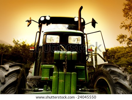 The Tractor whit sunset - stock photo