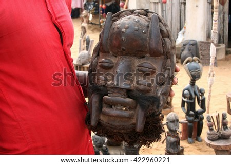 the traditional african mask related to voodoo for sale as souvenir on market of annual beninese