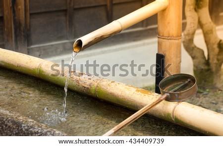 The Traditional Bamboo Fountain in Osaka ,Japan - stock photo