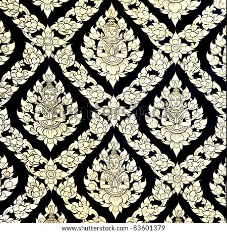 The Traditional Thai style art golden painting pattern on the wall in temple. This is traditional and generic style in Thailand. No any trademark or restrict matter in this photo. - stock photo