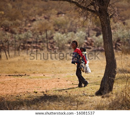 The traditional way to carry a child in Africa - stock photo