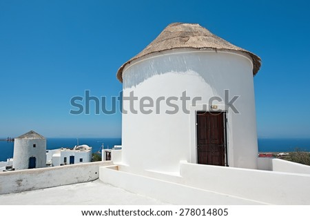 The traditional whitewashed architecture of Oia, Santorini, Greece - stock photo