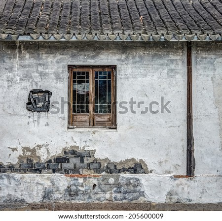 The traditional window and brick wall of old building - stock photo
