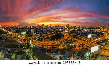 The traffic jam on expressways of Bangkok city with colorful sky twilight, tilt-shift blur effect - stock photo