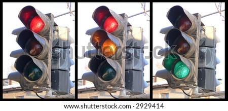 The traffic light fixed on a column at a crossroads - stock photo