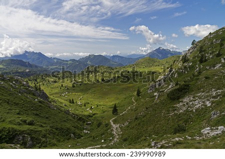 The trail in the mountains. Alps, Italy, summer. - stock photo