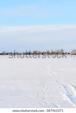 The trail to the shore from the village across the frozen sea.