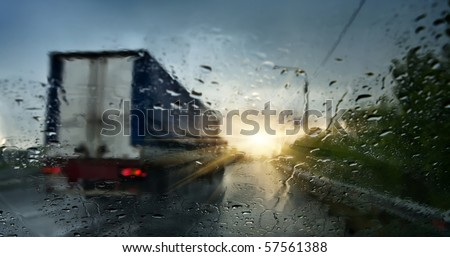 The trailer carries cargo during a storm - stock photo
