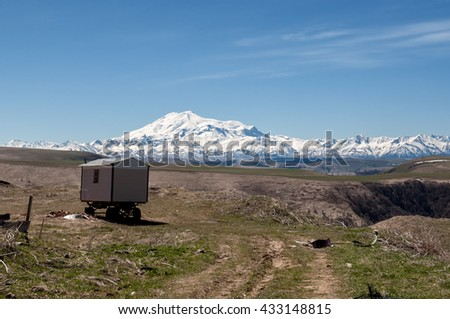 the trailer on wheels for builders near the Elbrus